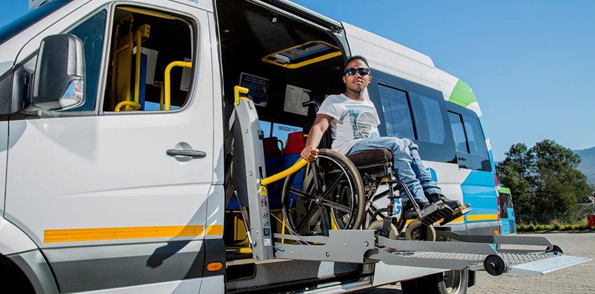 Passenger using minibus hoist