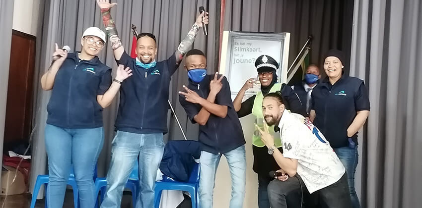 The group of communication champions who form the drama group posing for a fun photo on the stage of the school hall at Van Kervel School.